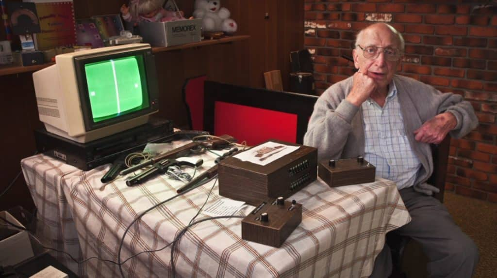 Ralph Baer sitting Odyssey Video Game Console